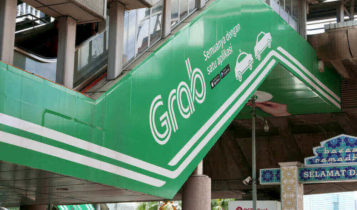 A grab advertisment is shown on the wall of a staircase