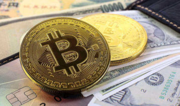 bitcoin with dollar bills as background