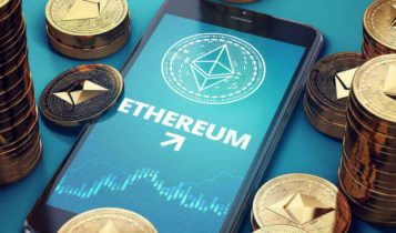 Ethereum logo and a chart below shown on a mobile phone with coins scattered around