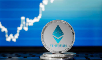 Etherum coins in front of graph