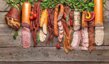 Various pork products neatly placed on a wood background based on new tariffs
