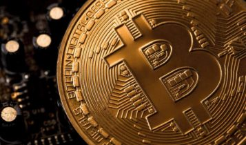 bitcoin logo is engraved on a coin
