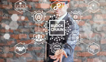 a man on the background showing a blockchain concept on his palm