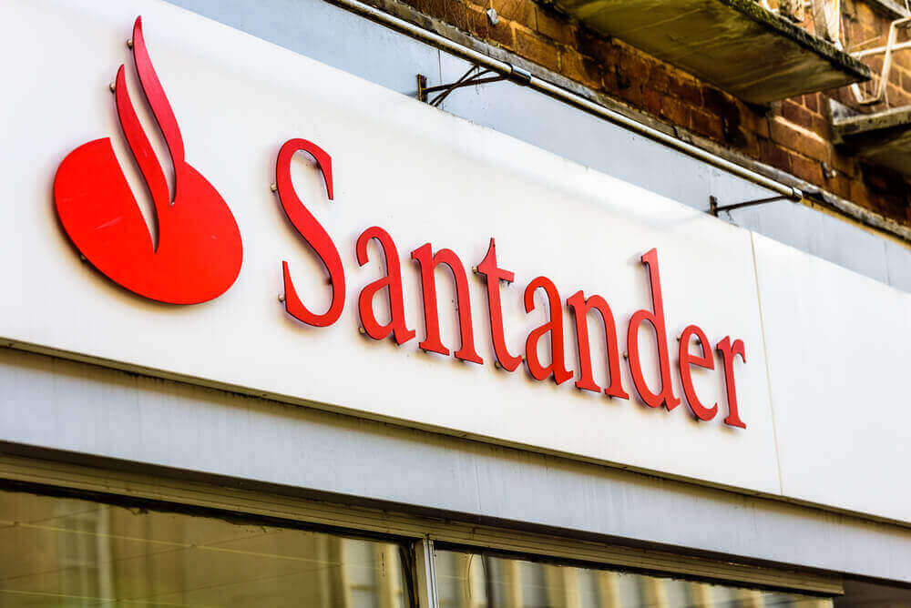 the logo of Santander attached to a sign