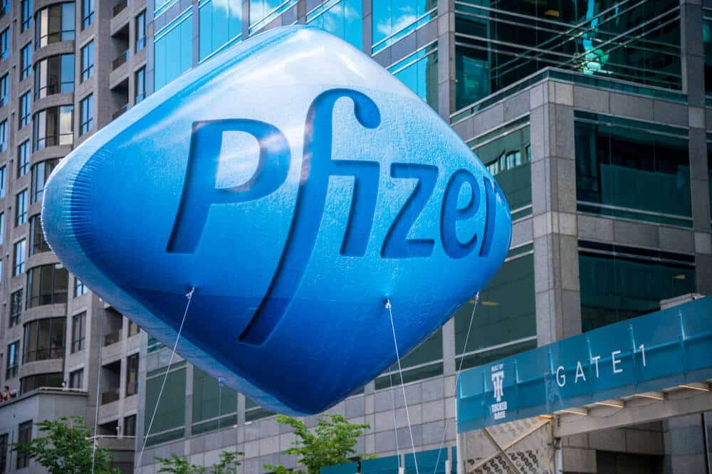 a blue balloon with the pfizer logo on it