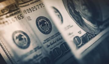 Dollar eases on 11-month peak as trade turmoil looms