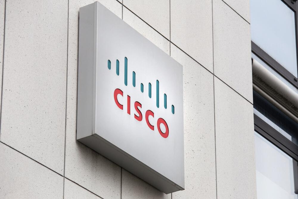 Cisco, Exxon Mobil shares fall
