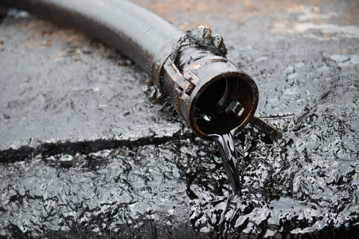 Finance Brokerage-Oil Inventory Report: Oil prices concept, oil pipe leaking sticky black fluid