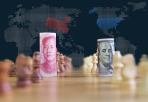 Finance Brokerage-Biggest Economies: Trade war concept with yuan and dollar in the midst of chess pieces