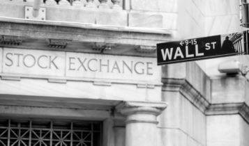 Finance Brokerage-Stock Exchanges: outside shot of Wall Street sign, Stock exchange written on wall