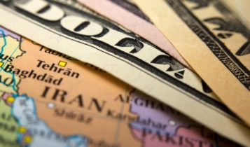 Finance Brokerage-oil inventory report: dollar bills on top of map of Iran