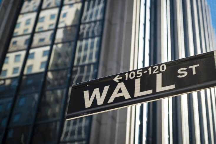 Finance brokerage-Share Market: outside of a Wall Street sign