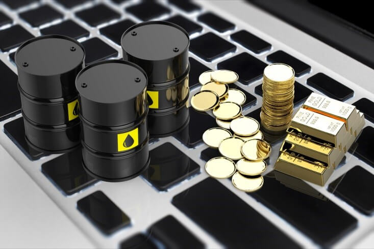 Finance Brokerage-Futures Trading: miniature oil barrels and gold coins and bars on top of a keyboard