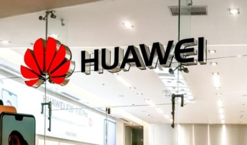 Finance Brokerage-Huawei: Outside shot of Huawei office with a smartphone on the side