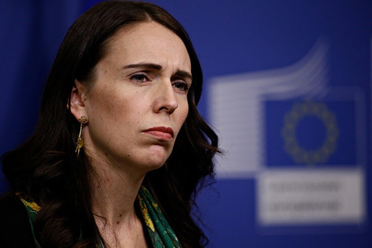 Finance Brokerage-New Zealand Government: Prime Minister Jacinda Ardern portrait looking at something off-cam