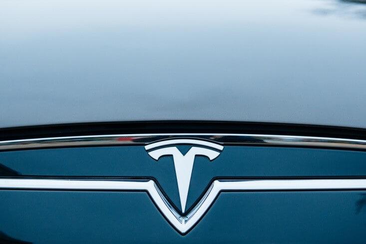 Tesla Motors_Close-up shot of Tesla logo-FinanceBrokerage