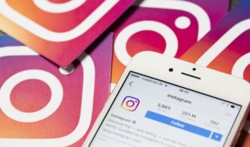 Data Privacy-Instagram app open on a smartphone with IG logos on the background-Finance Brokerage