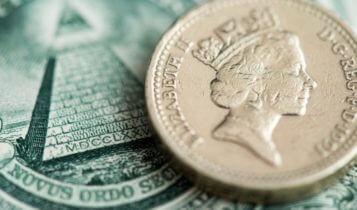 Forex Markets – British pound and dollar bill close-up shot – Finance Brokerage