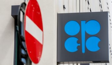 Futures Trading – OPEC symbol beside a no entry street signage – Finance Brokerage