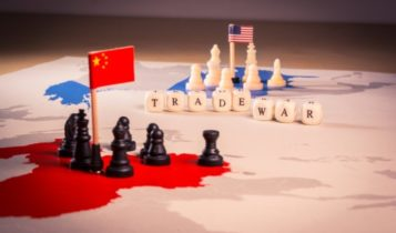 Import Tariffs – chess pieces on top of Chinese and American territories – Finance Brokerage