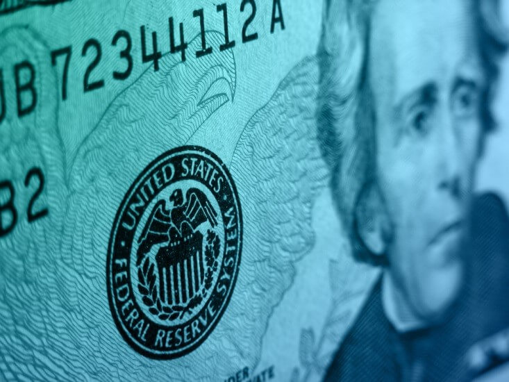 The Federal Reserve – close-up of a dollar bill showing the Federal Reserve logo - Finance Brokerage