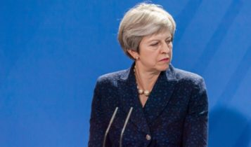 UK Prime Minister – Theresa May looking at her left during a speech – Finance Brokerage