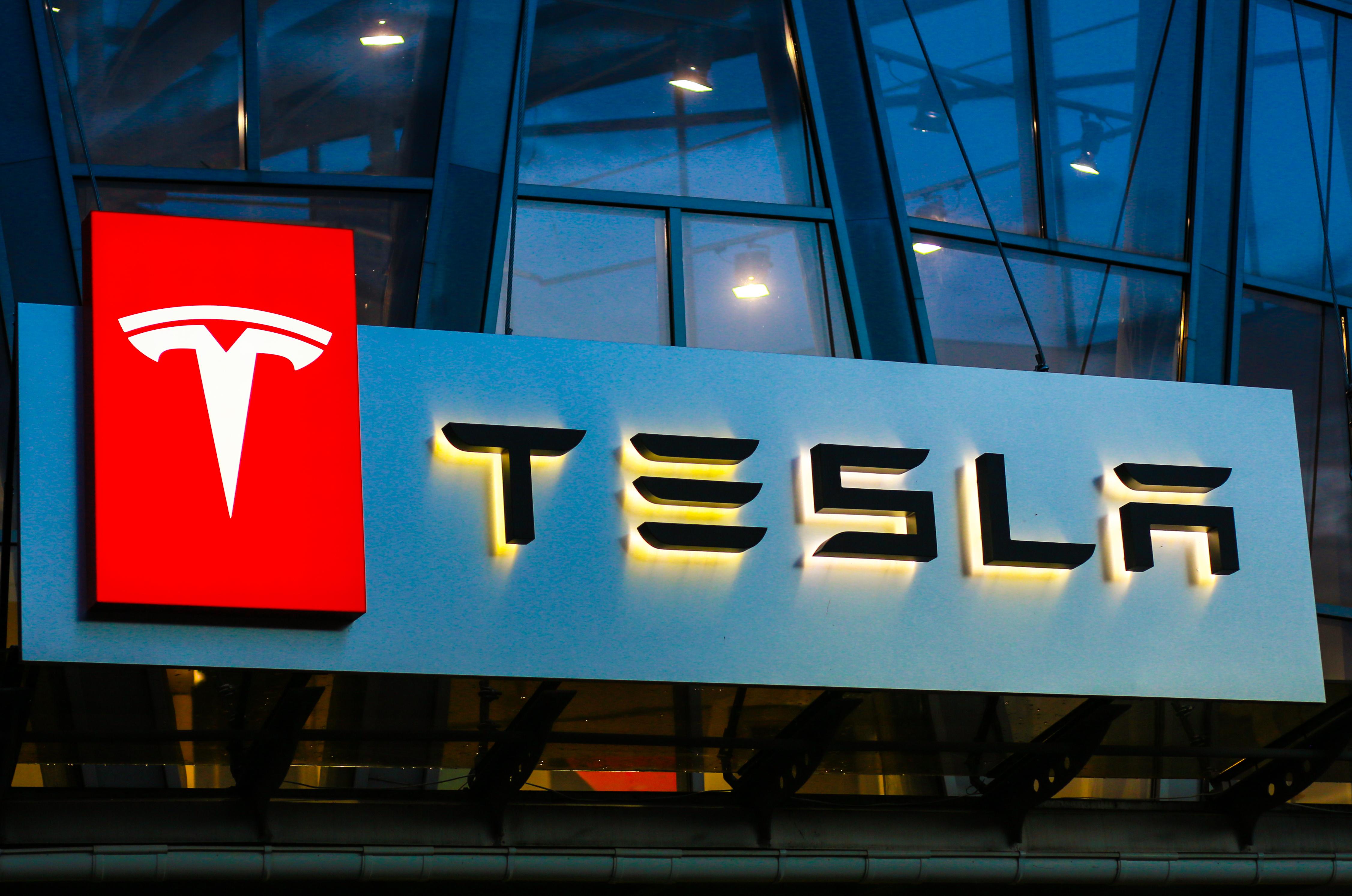 Tesla banner and stocks