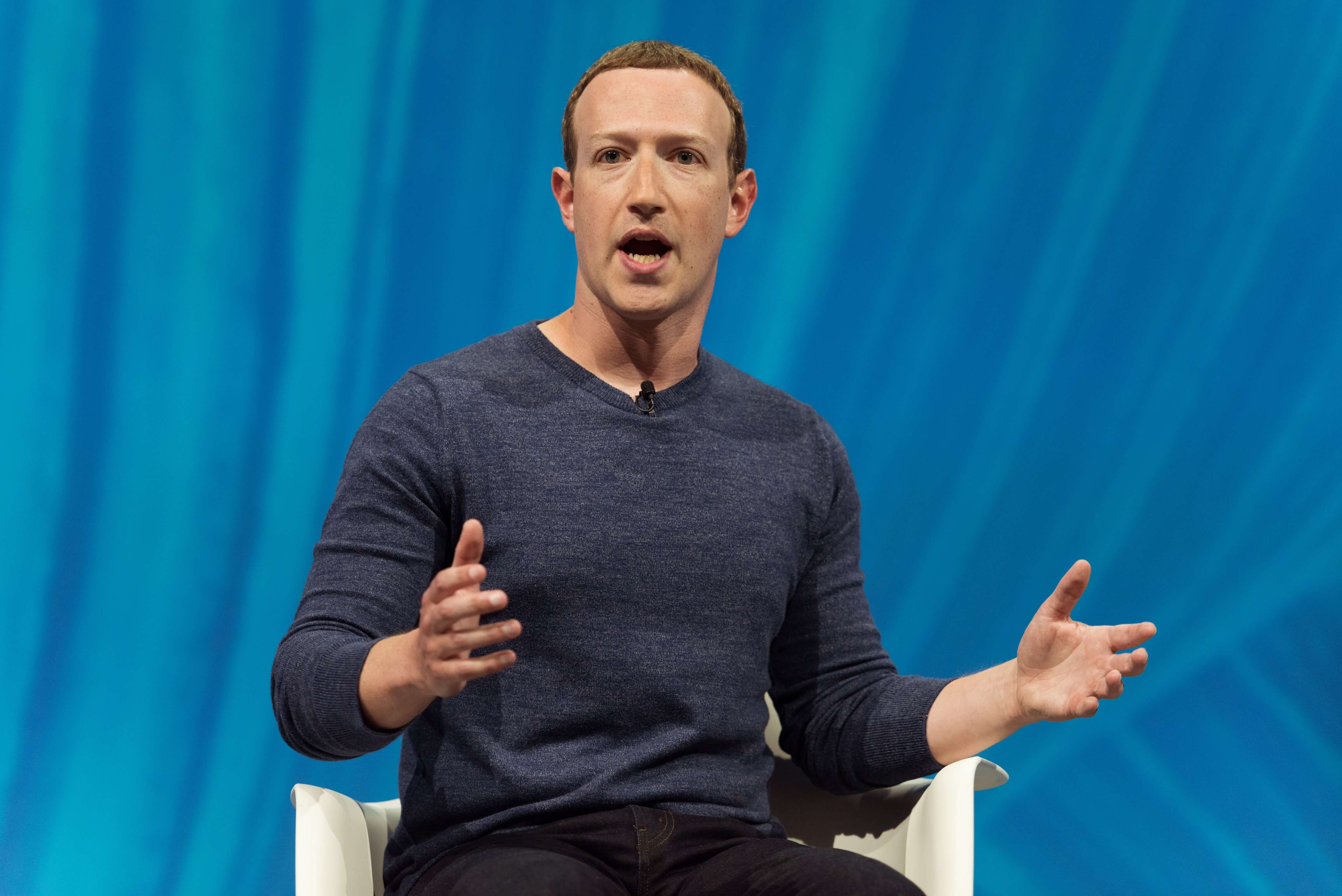 Zuckerberg speaking at a conference