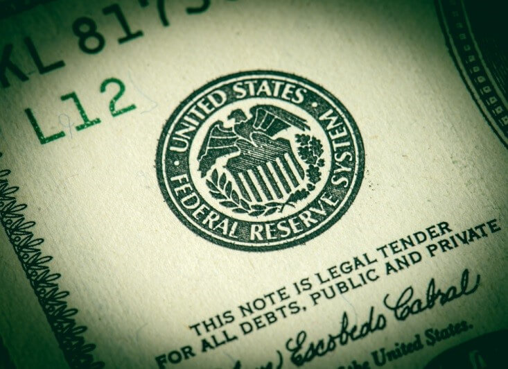 US Federal Reserve – close up shot of the Fed's logo on a dollar bill – Finance Brokerage
