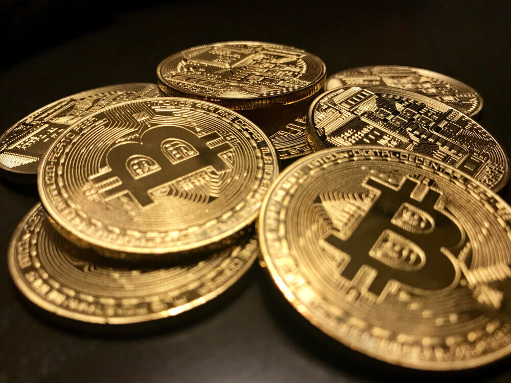 Closeup of a pile of Bitcoin coins gold.