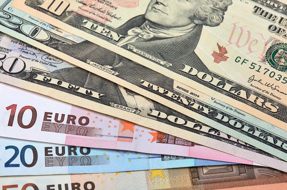 Banknotes of euros and dollars closeup.