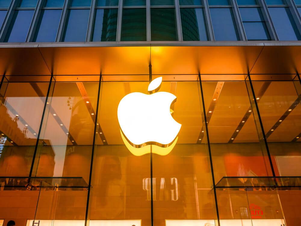 Finance Brokerage – Apple: Apple logo with yellow lights.