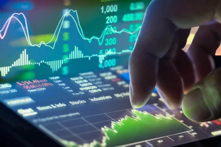 Finance Brokerage – forex news: a hand touching a trading platform