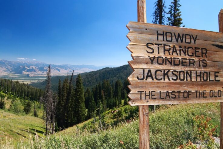 Finance Brokerage – FX news: sign at the entrance of Jackson Hole