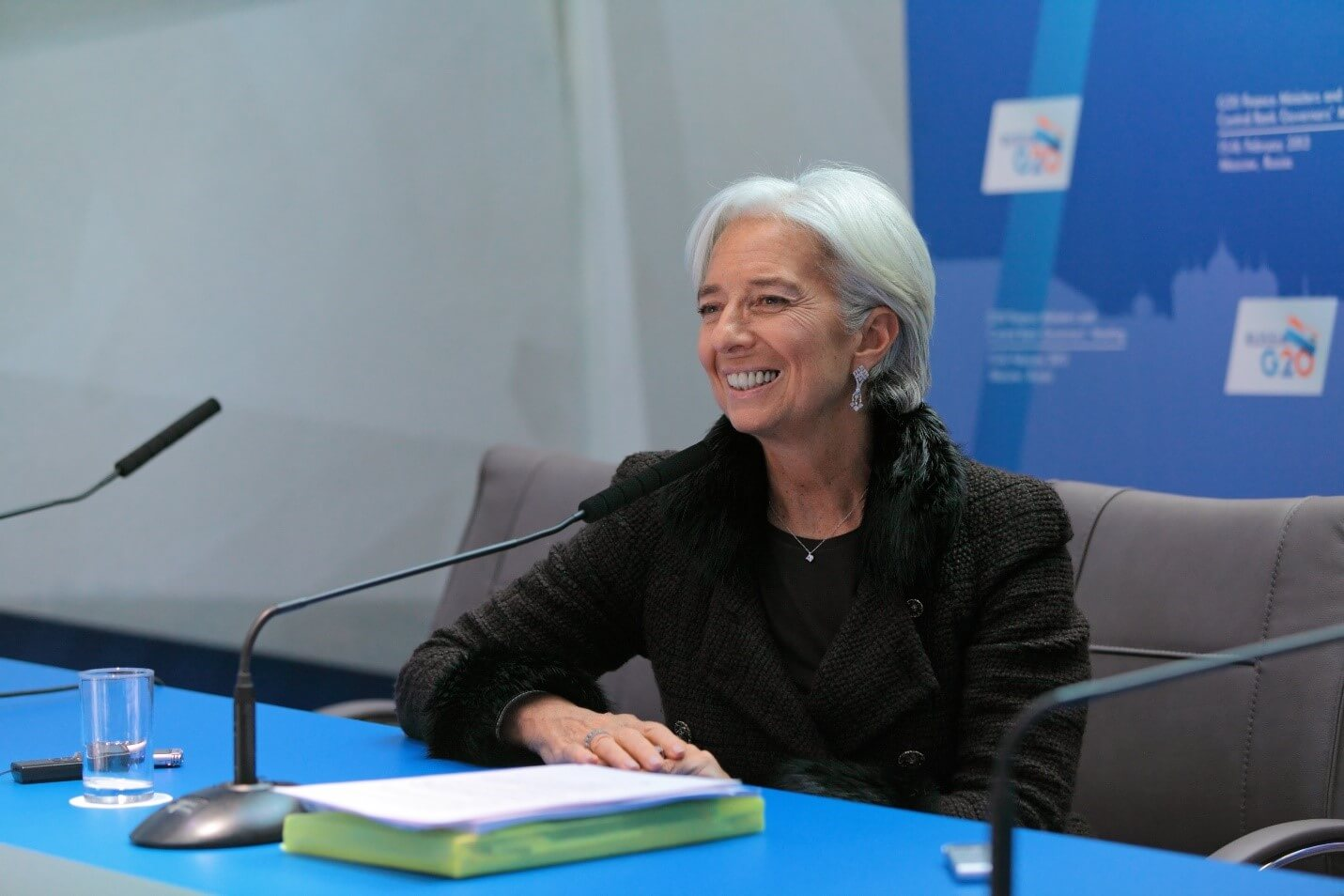 Christine Lagarde smiling in a press conference