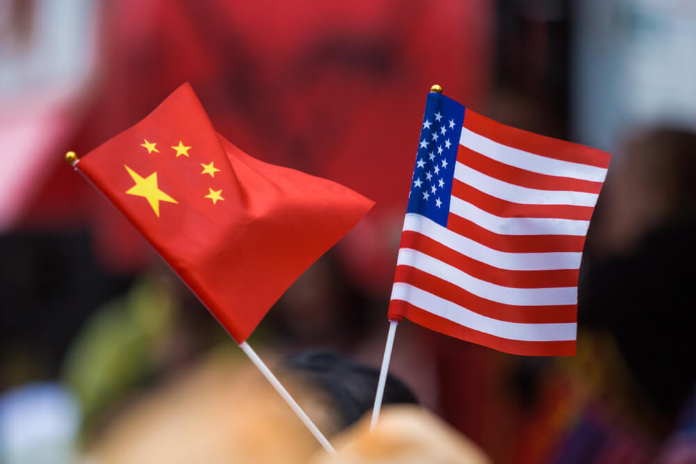 Photo of Chinese and American flags flying side by side – Finance Brokerage