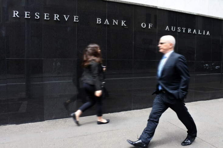 Finance Brokerage – man and woman walking in front of the Reserve Bank of Australia