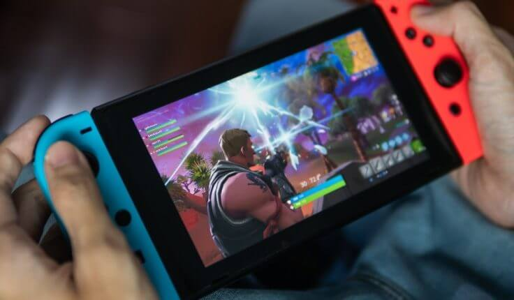 Nintendo Switch between two hands – Finance Brokerage