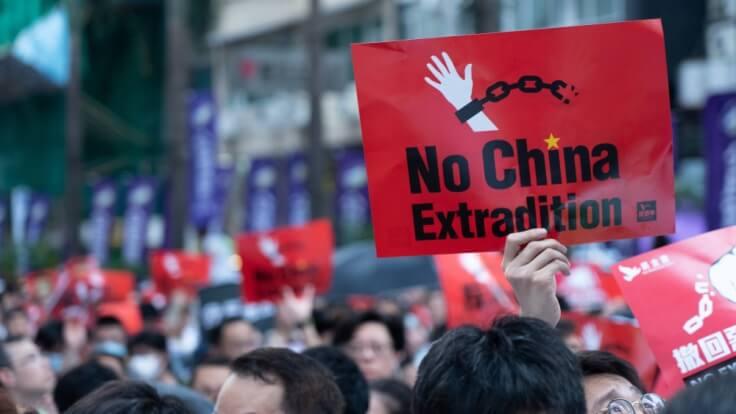 Finance Brokerage – FX News – HK Protester Holding placard