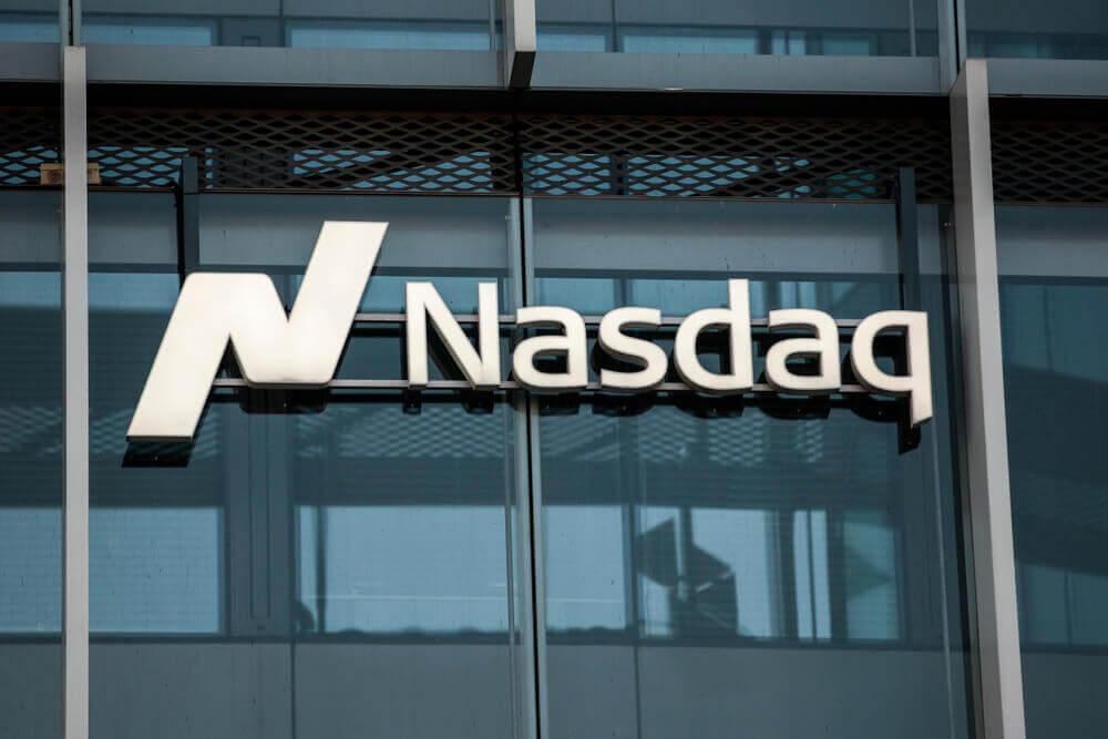 Finance Brokerage – NASDAQ: NASDAQ logo in their building.
