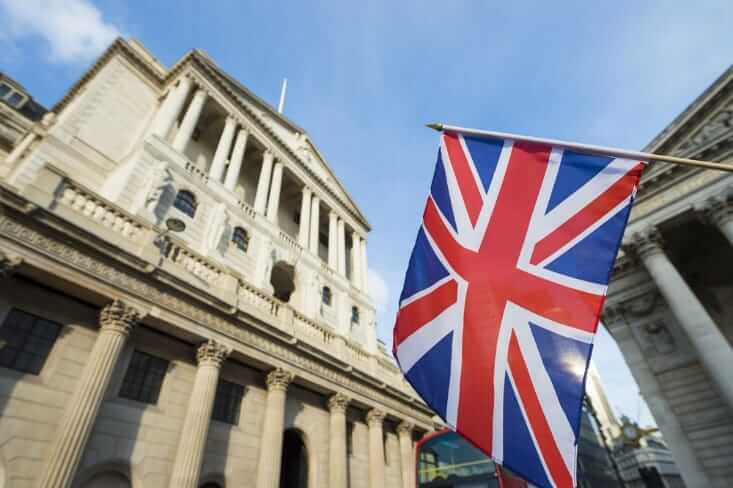 fx news - Britain flag in front of the bank of England – finance brokerage