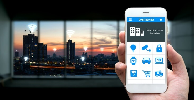 hand holding phone IoT concept – Finance Brokerage