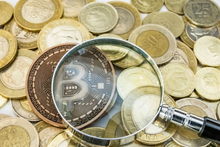 physical bitcoin under magnifying glass