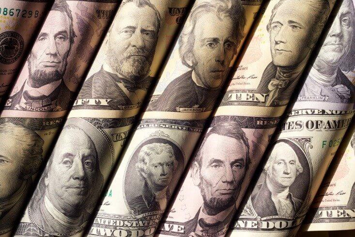 currency markets; rolled dollar bills – FinanceBrokerage