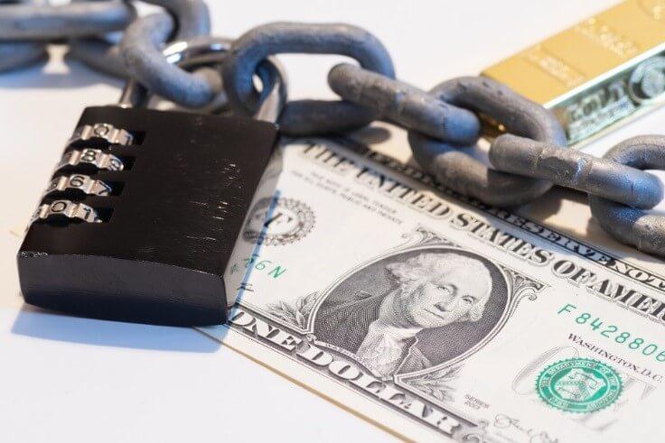 fx market concept; closeup, one dollar in chains – financebrokerage