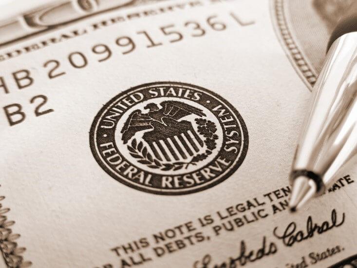US federal reserve seal on a bill – FinanceBrokerage