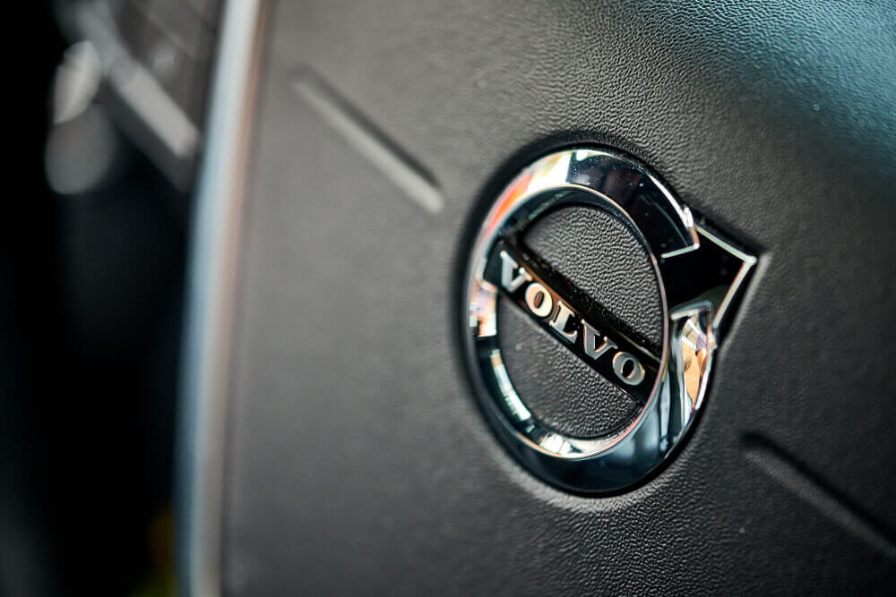Volvo: The Volvo interior detail of steering wheel, airbag, and horn.