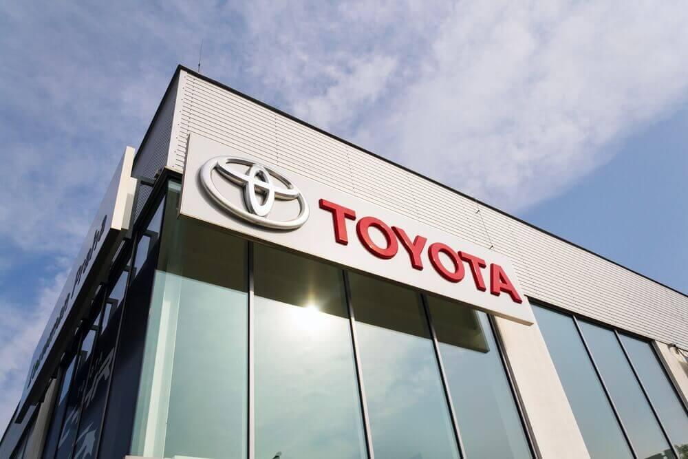 Toyota: Toyota motor corporation logo on dealership building