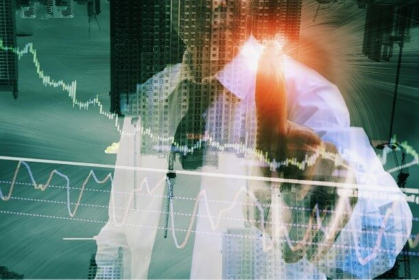 A businessman reviewing his business report in a forex graph – Finance brokerage