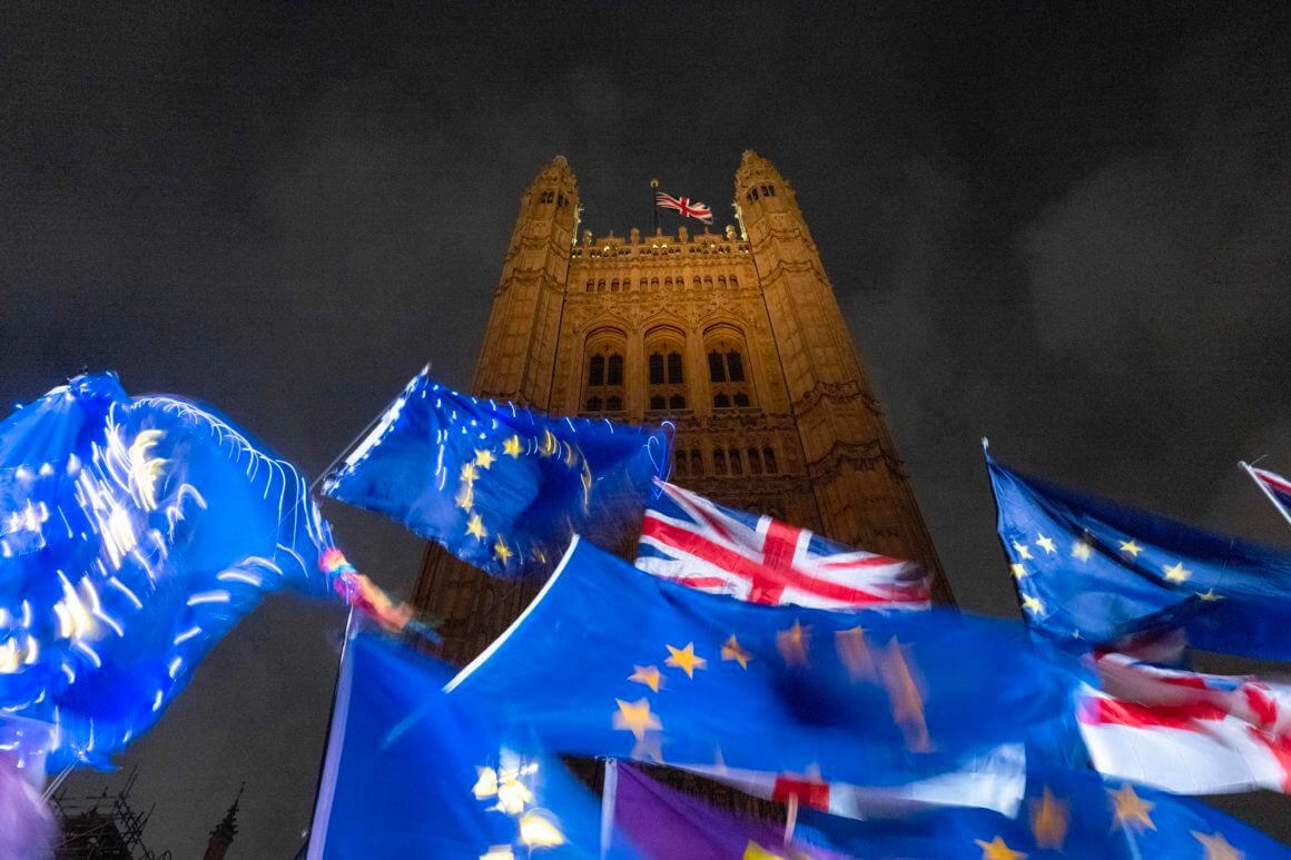 """TOPSHOT - EU and Union flags flutter in the breeze as Pro and anti-Brexit demonstrators protest outside of the Houses of Parliament in central London on October 21, 2019. - UK Parliament Speaker John Bercow blocked British Prime Minister Boris Johnson from holding a vote Monday on his new Brexit divorce deal after MPs failed to back it on Saturday. """"The motion will not be debated today as it would be repetitive and disorderly to do so,"""" Bercow told lawmakers in the House of Commons. (Photo by Tolga AKMEN / AFP) (Photo by TOLGA AKMEN/AFP via Getty Images)"""